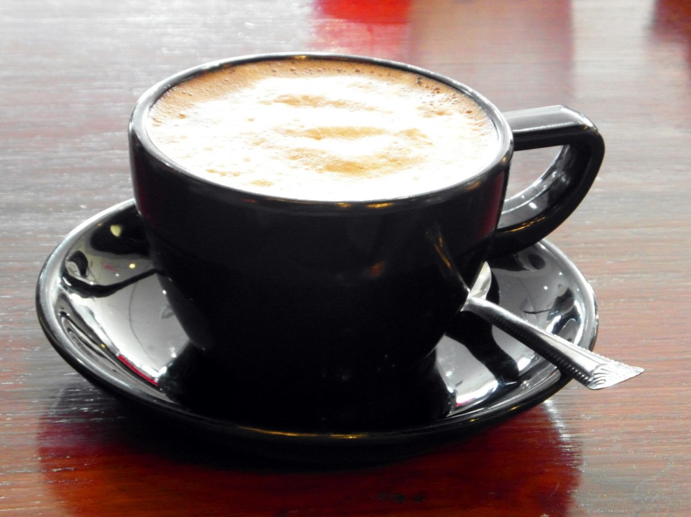 latte-in-a-black-coffee-cup
